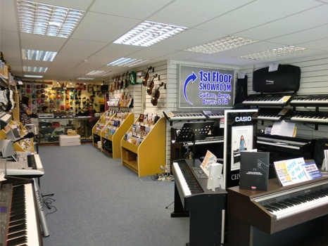 Image of the ground floor at our Rimmers Music Wigan store featuring electric pianos, keyboards and electric guitars amongst other instruments.