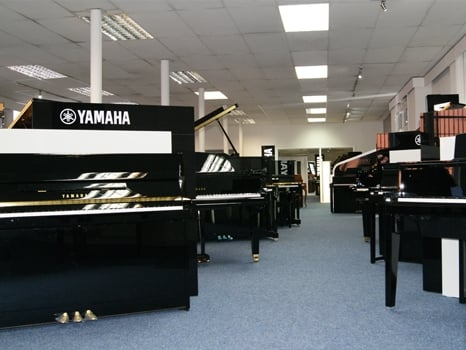 A view of some of the wide range of Yamaha acoustic pianos available at Rimmers Music Bolton