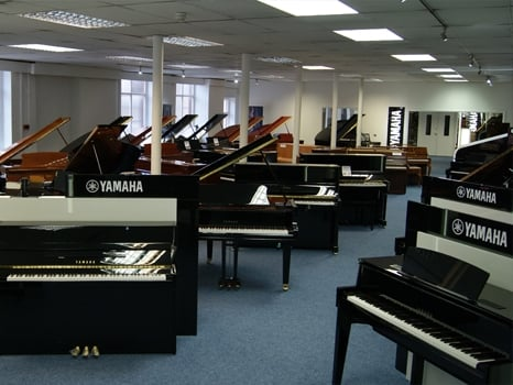 An overview of our ground floor piano showroom at Rimmers Music Bolton