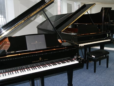 A view of two of the premium high end Steinway & Sons Grand Pianos we have available at Rimmers Music Bolton